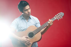 Asian Student playing guitar Royalty Free Stock Image