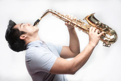 Asian Student playing saxophone Royalty Free Stock Images