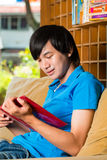 Asian student reading book or textbook learning Stock Images