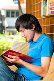 Asian student reading book or textbook learning Stock Image