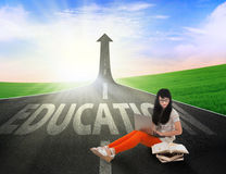 Asian student reading books on education road outdoor Royalty Free Stock Photo