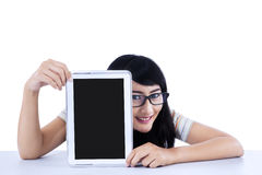 Asian student showing a tablet computer Stock Photos