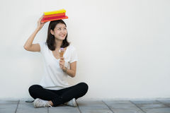 Asian student sit and relax with ice cream. In university Royalty Free Stock Photo