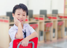 Asian student smiling in comuter room Stock Image
