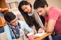 Asian student studying with classmates in classroom Stock Photo