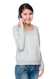 Asian student talk to cellphone Stock Images