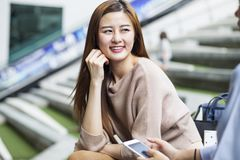 Asian student talking with her friend. Royalty Free Stock Photo