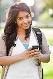 Asian student texting. A shot of an asian student texting with her cellphone on campus Royalty Free Stock Photo