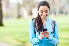 Asian student texting on the phone stock photo