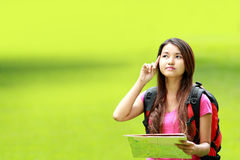 Asian student thinking something in the park Royalty Free Stock Photography