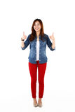 Asian student with thumbs up sign Stock Image