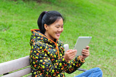 Asian student use ipad Royalty Free Stock Photography