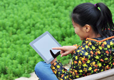 Asian student use ipad 4. Asian student sitting on bench and use ipad 4 Stock Photo