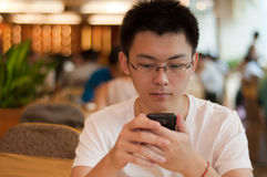 Asian student using new phone Stock Image