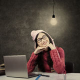 Asian student in winter clothes looking at lamp Stock Photos