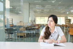 Asian student wondering or thinking about something Stock Image