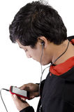 Asian student working on smartphone Stock Image
