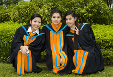 Asian students on their graduation day. Proud and happy asian students posing on their graduation day Royalty Free Stock Images