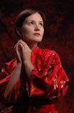 Asian style. Emotion woman in red asian dress royalty free stock photo