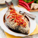 Asian Style Baked Fish With Chili, Ginger and Soy Sauce Dressing Royalty Free Stock Image