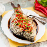 Asian Style Baked Fish With Chili, Ginger and Soy Sauce Dressing Royalty Free Stock Photography