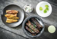 Asian style barbeque spicy pork ribs with sweet soy sauce. Modern gourmet asian style barbeque spicy pork ribs with sweet soy sauce set meal Stock Photos