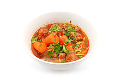 Asian style beef noodles. (bo kho) in soup isolated on white stock photo