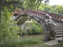 Asian style bridge in a park. Asian style, detailed bridge found in a park Royalty Free Stock Photography