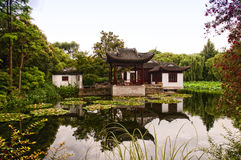 Asian style buildings on a pond Royalty Free Stock Image