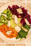 Asian Style Chargrilled Chicken Salad With Red Cabbage Carrots E. Damame Beans and Hummus On A Tiled Kitchen Worktop or Counter Royalty Free Stock Photo