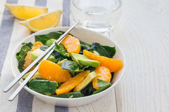 Asian style healthy spinach, avocado and orange salad with ginger-vinegar dressing, copy space Royalty Free Stock Photo