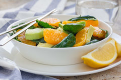 Asian style healthy spinach, avocado and orange salad with ginger-vinegar dressing Stock Photos