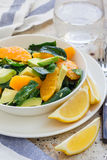 Asian style healthy spinach, avocado and orange salad with ginger-vinegar dressing Royalty Free Stock Photography