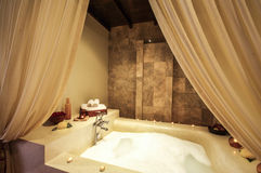 Asian style jacuzzi in spa room Royalty Free Stock Photography