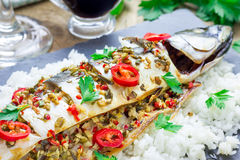 Asian style mackerel baked with ginger, red chili, coriander and spring onion. Asian style mackerel baked with ginger, red chilli, coriander and spring onion on Royalty Free Stock Photos