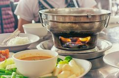 Asian Style Metal Hot Pot with Flame Underneath stock photos