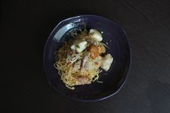 Asian style noodle with variety of pork and fish balls. Thai Food royalty free stock image
