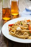 Asian style noodles. With chicken vegetables and tofu Stock Photo