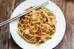 Asian style noodles. With chicken vegetables and tofu Royalty Free Stock Photo