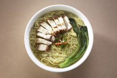 Asian style noodles with crispy pork Royalty Free Stock Photos