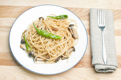Asian style pasta. Pasta with mushrooms and green pepper Stock Photos