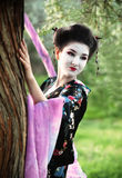 Asian style portrait of woman near the tree Royalty Free Stock Photo