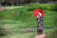 Asian style portrait of woman with umbrella Stock Photo