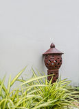 Asian style pottery garden lamp Stock Images