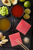 Asian style: Raw fresh tuna with ingredients for cooking close-u. P on the table. Top view from above vertical Stock Image