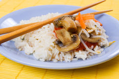 Asian style rice with mushrooms and vegetables Stock Photos