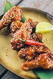 Asian Style Spicy Chicken Wings Appetizer. With Lime and Hot Sesame, close-up Stock Images