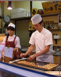 Asian style street food. Cooking chef on the outside kitchen Royalty Free Stock Images