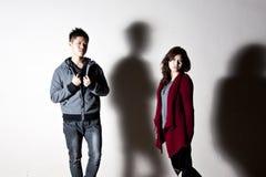 Asian stylish fashioned couple on street Royalty Free Stock Photos