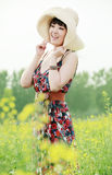 Asian summer girl. Charming Asian girl posing in summer rape field Stock Photography